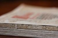 Newspapers on pile